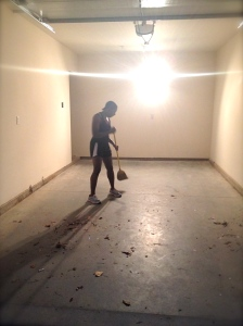 Rach sweeping out the now empty garage.